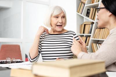 senior woman getting speech therapy