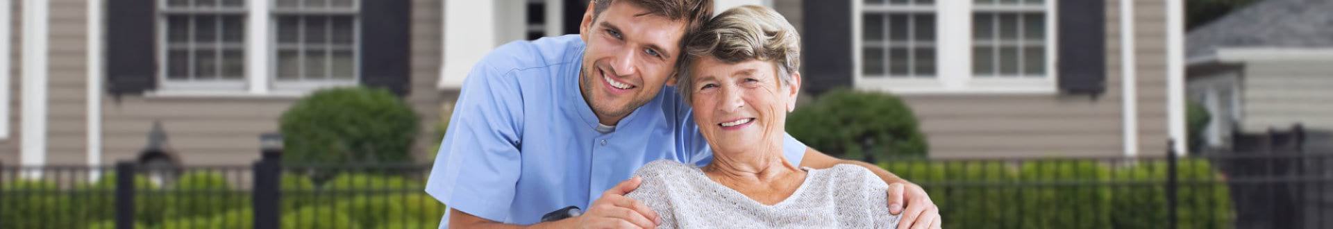 senior woman with male caregiver smiling